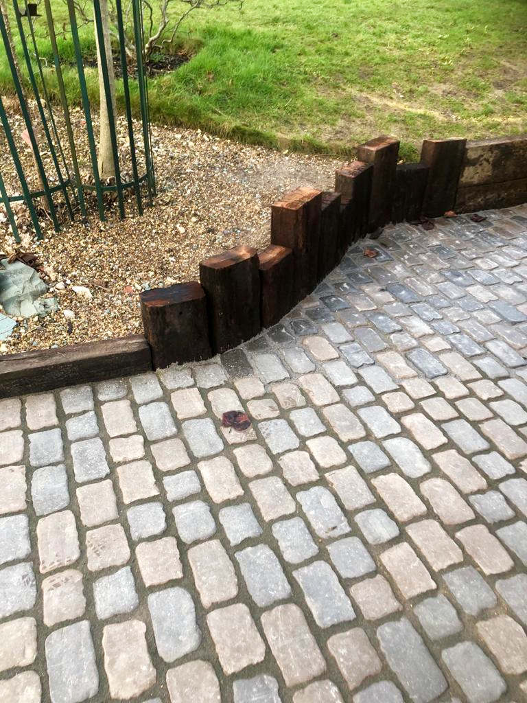 Raised castled sleeper wall and cobbled path
